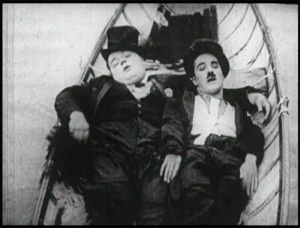 Arbuckle and Charlie Chaplin in The Rounders.