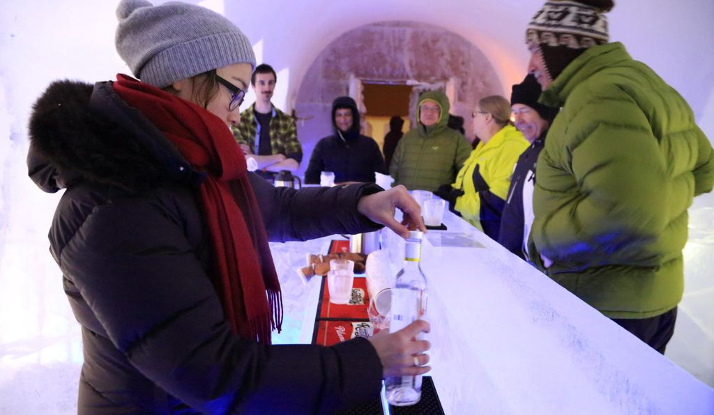 Festival-goers enjoy the ice bar.