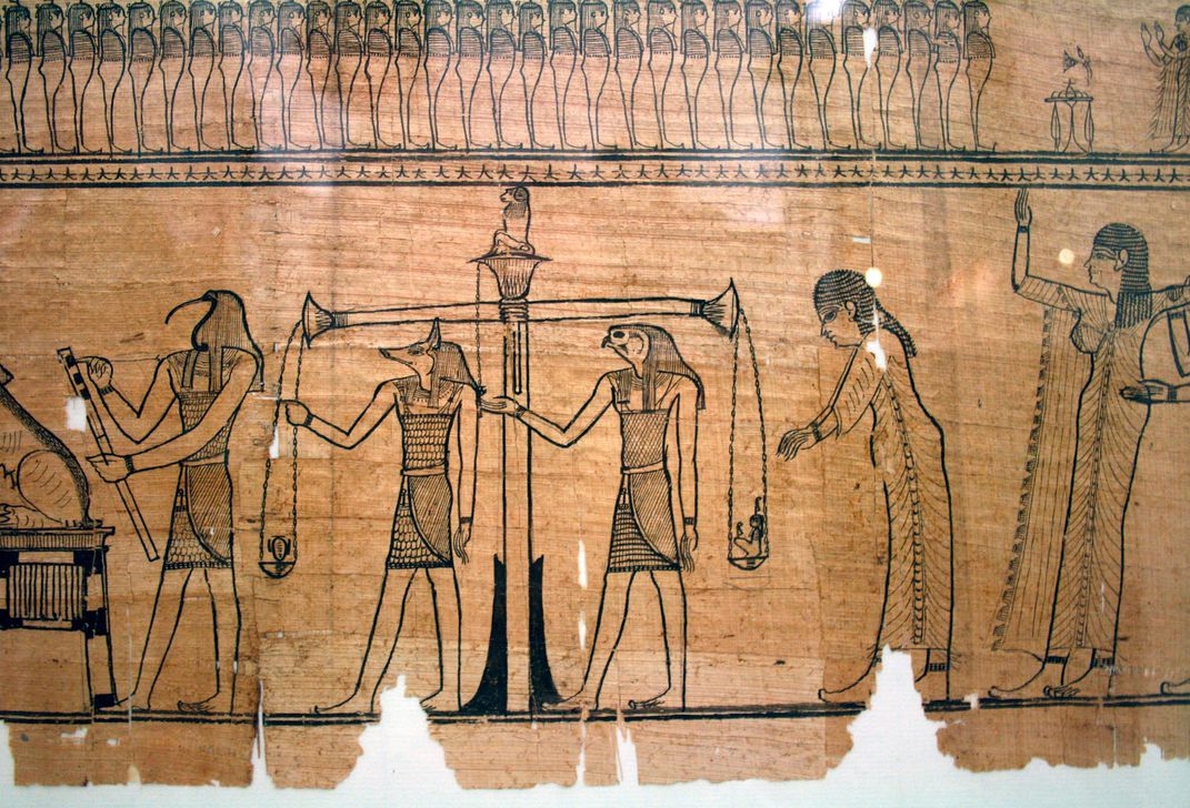 The Weighing of the Heart ritual, as shown in the <em>Book of the Dead</em> of Sesostris