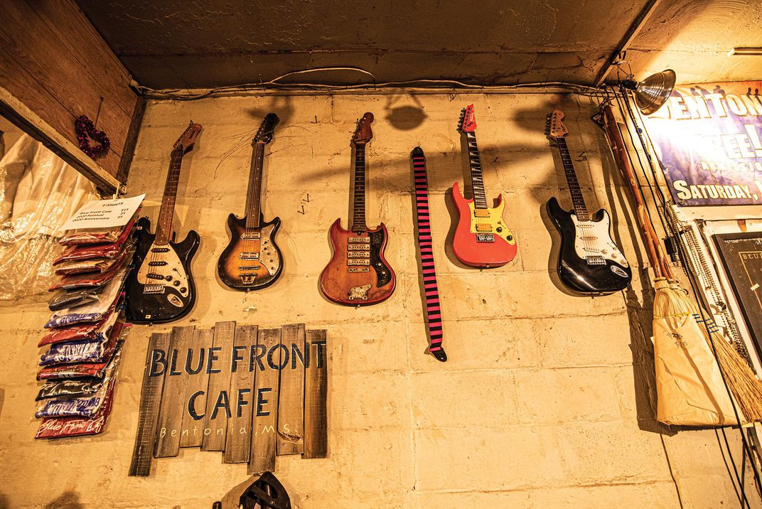 Guitars on wall at Blue Front Cafe