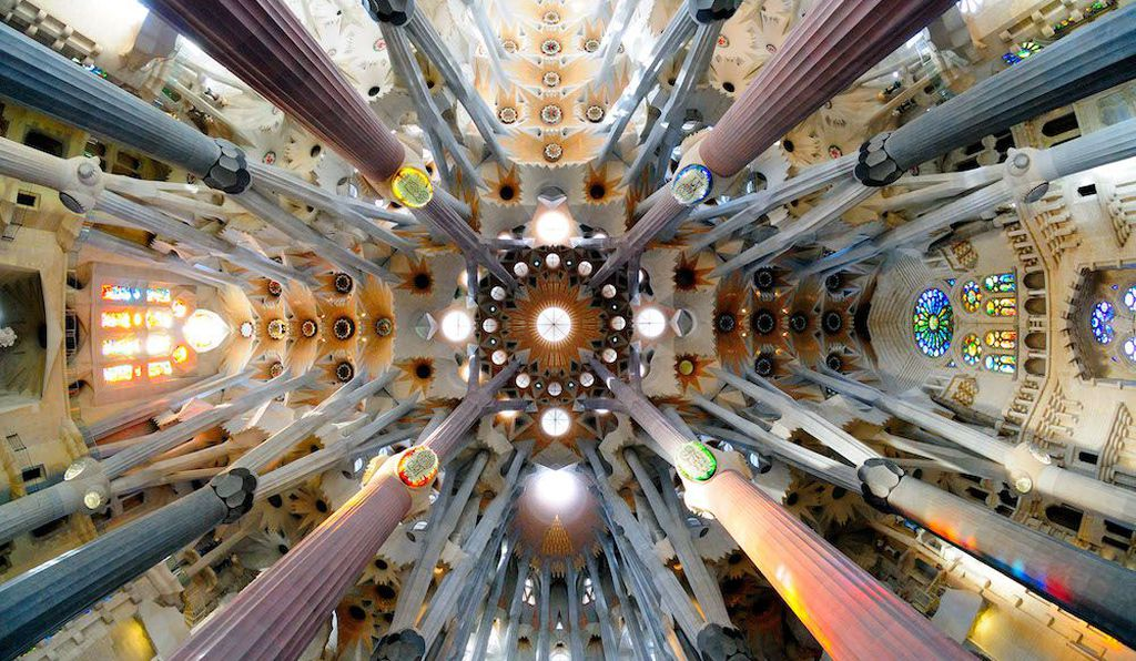 Sagrada Família, Spain. Light floods in through the stained glass windows to illuminate the Sagrada Família's intricate structure.