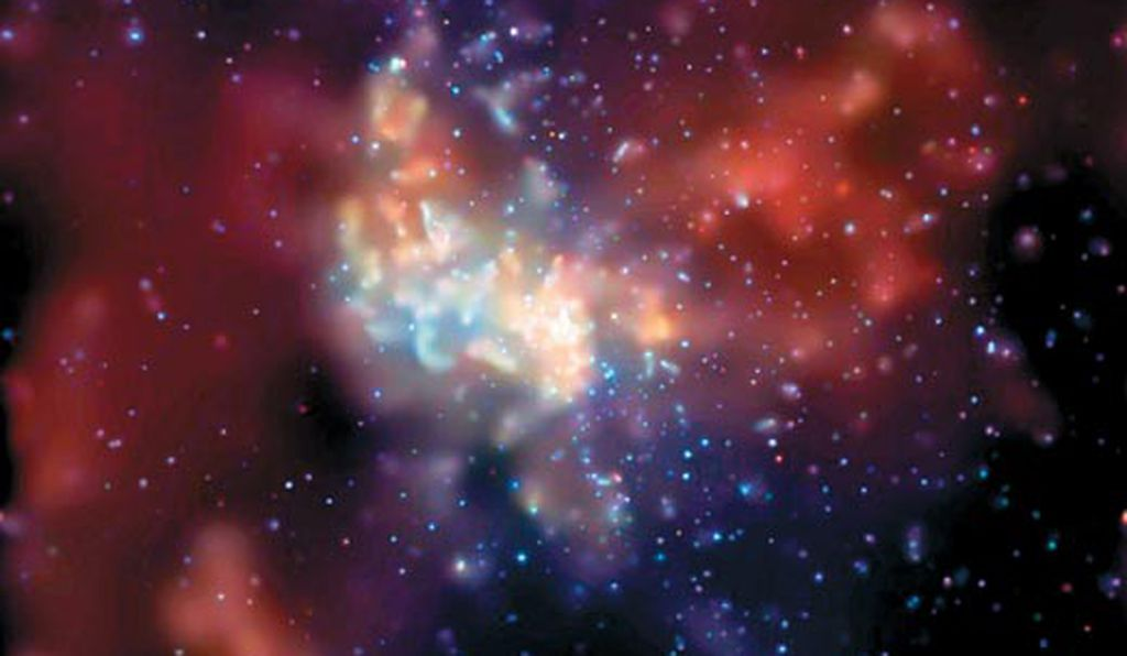 Our galaxy's black hole emits X-rays (made visible here in an image from the Chandra satellite telescope) as matter swirls toward it.