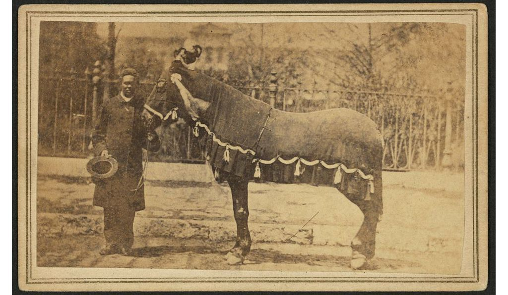 Rev. Henry Brown, with Abraham Lincoln's horse on the day of Lincoln's funeral
