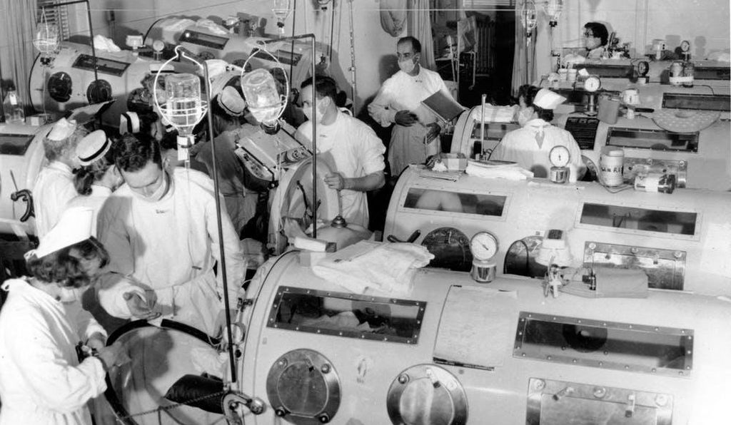 During the polio epidemic of summer 1955, a hospital in Boston helps patients breathe with iron lungs.