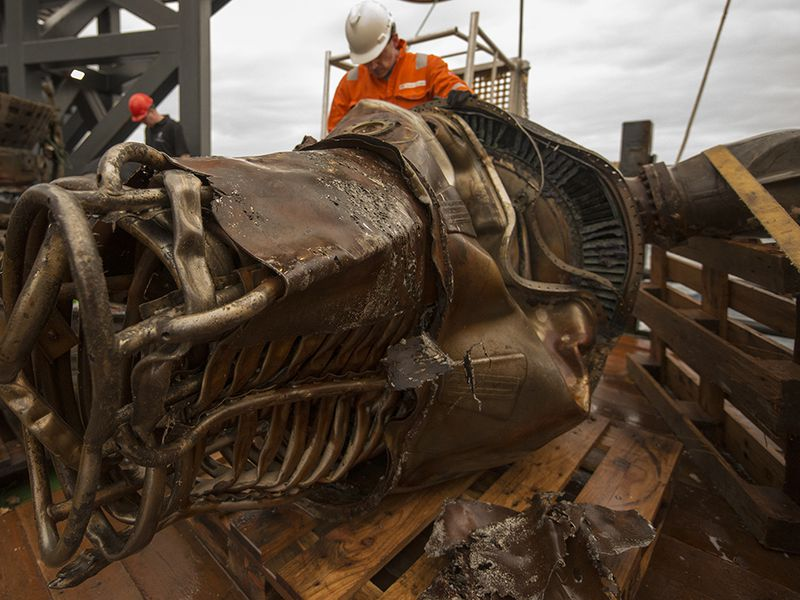 Workers clean the salvaged F-1 engine