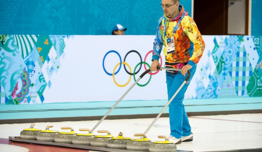 Curling stones weigh 44 pounds. They are concave, on bottom, which limits the contact they have with the ice.