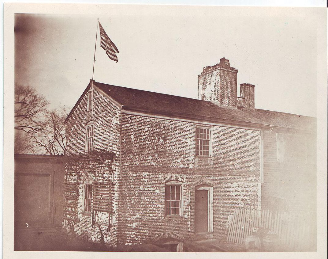 SQ_historic_exterior_with_flag_and_outbuilding_RHAPC.jpg