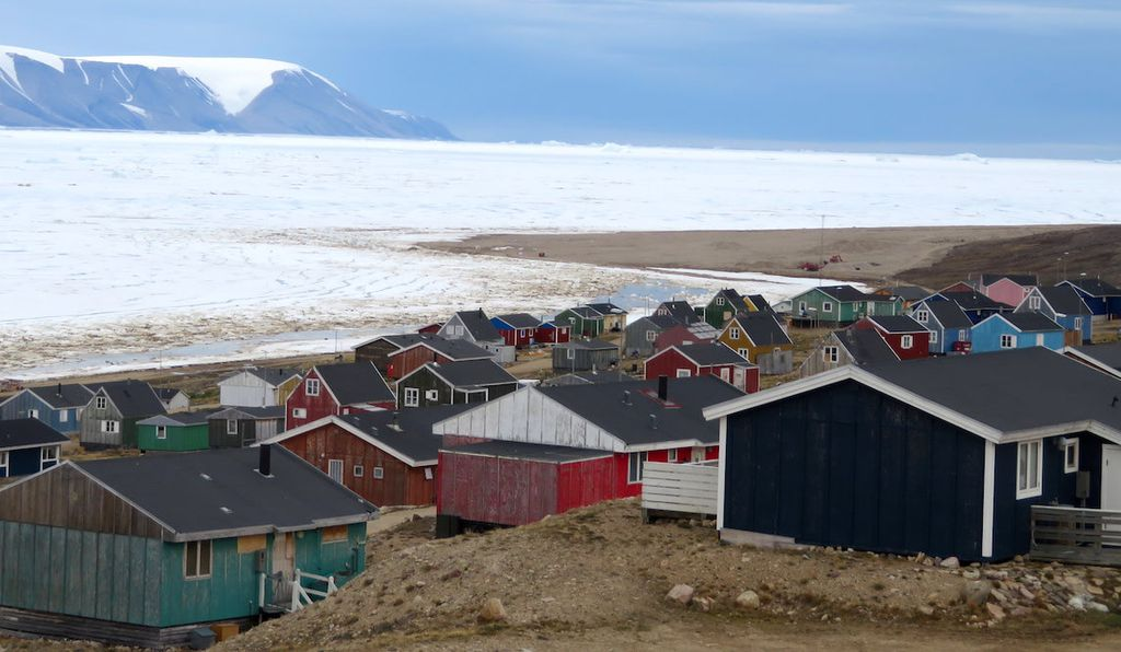 The village of Qaanaaq, Greenland, sits on the edge of a fjord that is ice-covered in winter.