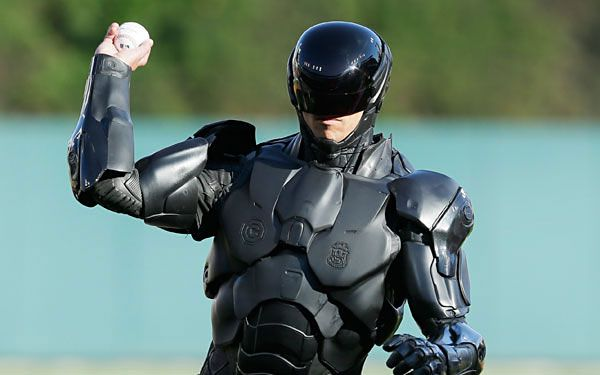 Robocop throws first pitch