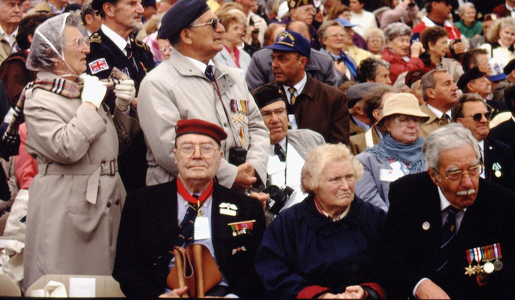 Hundreds of D-Day veterans and their families watch the D-Day memorial ceremony, 1994.
