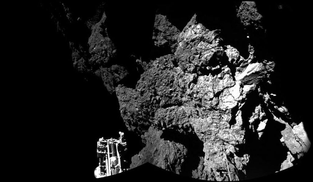 The Philae lander appears in a mosaic of two images taken on the surface of Comet 67P/Churyumov-Gerasimenko, shortly after landing on November 12, 2014.