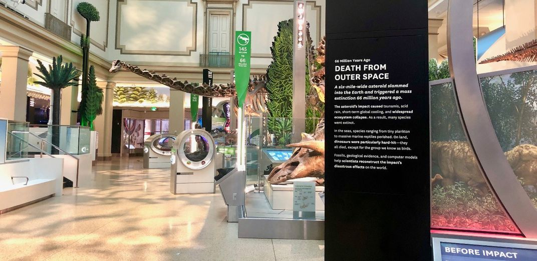 """Death From Outer Space"" in white on a black sign in the Smithsonian's new fossil hall."