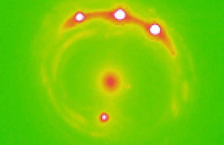 Astronomers Spot Signs of Planets Outside the Milky Way Extrasolar_planets