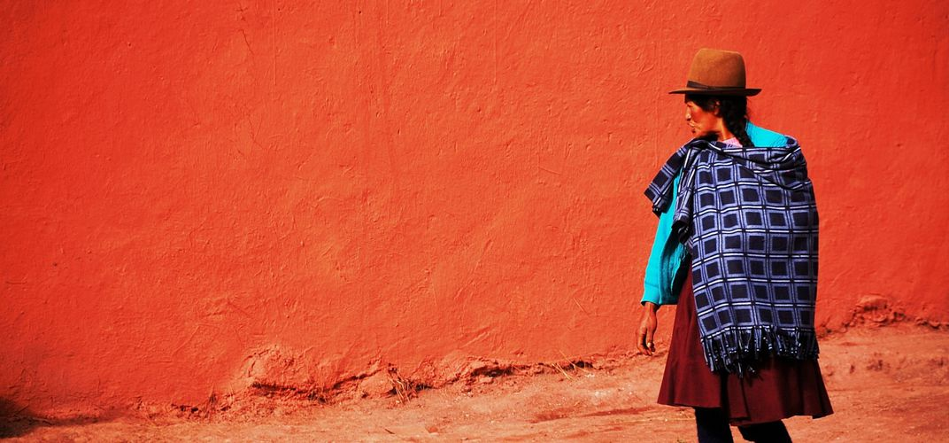 Quechua woman out for an afternoon stroll Credit: Lola Akinmade