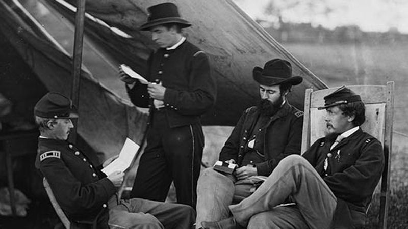 Civil War soldiers reading letters from home