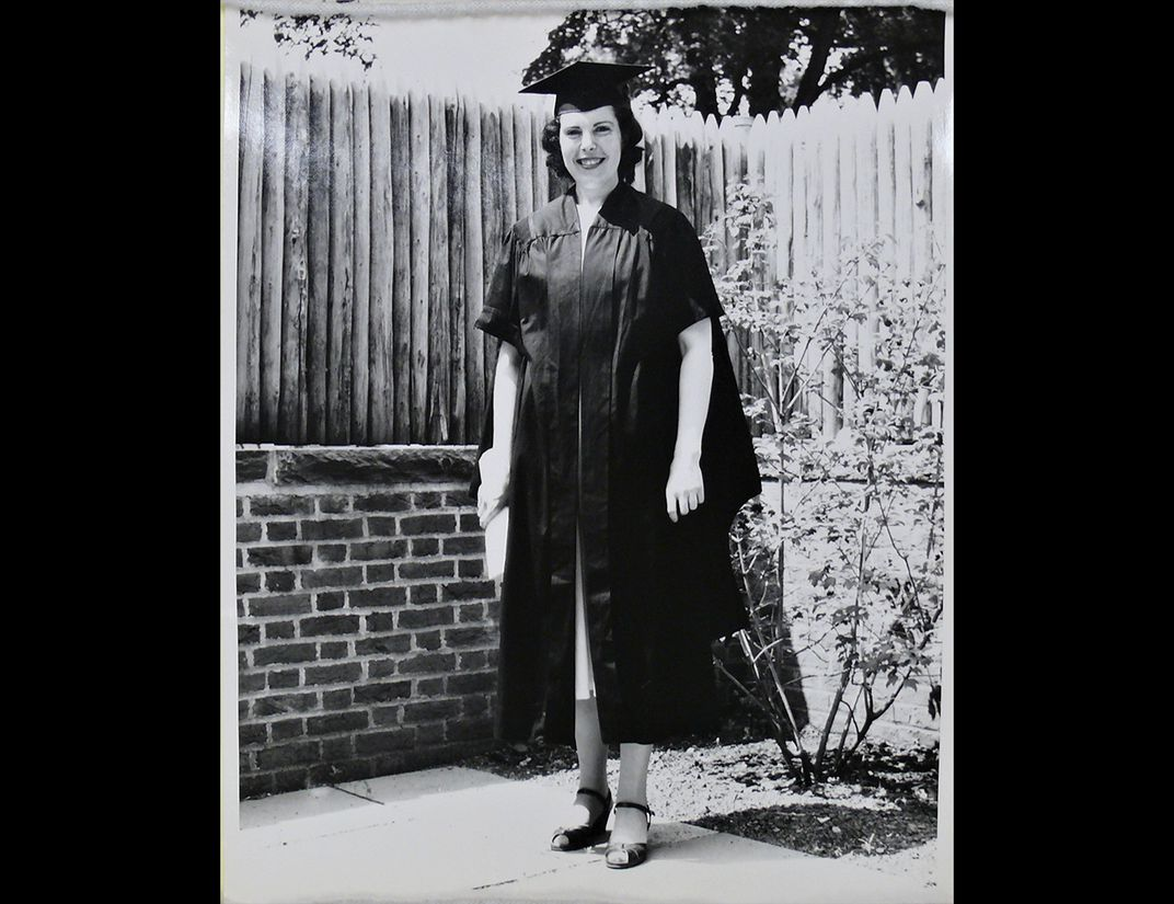 Black and white photo of Crimilda Pontes in graduation gown.