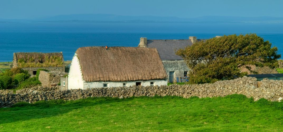 Traditional thatched cottage amid the landscape