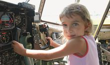 The authors daughter, spellbound by a Hercules C-130