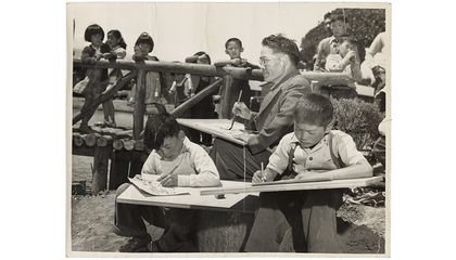Photograph of Chiura Obata teaching a children's art class at Tanforan Art School, 1942 / unidentified photographer. Chiura Obata papers, circa 1891-2000, 1942-1945. Archives of American Art, Smithsonian Institution.