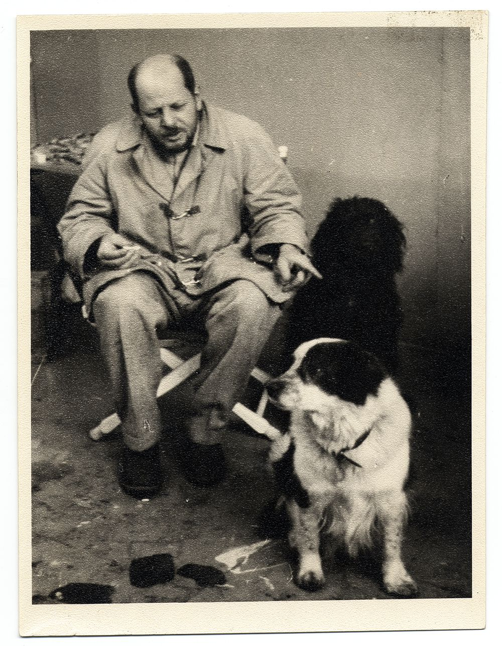 Photograph of Jackson Pollock with his pet dogs Gyp and Ahab
