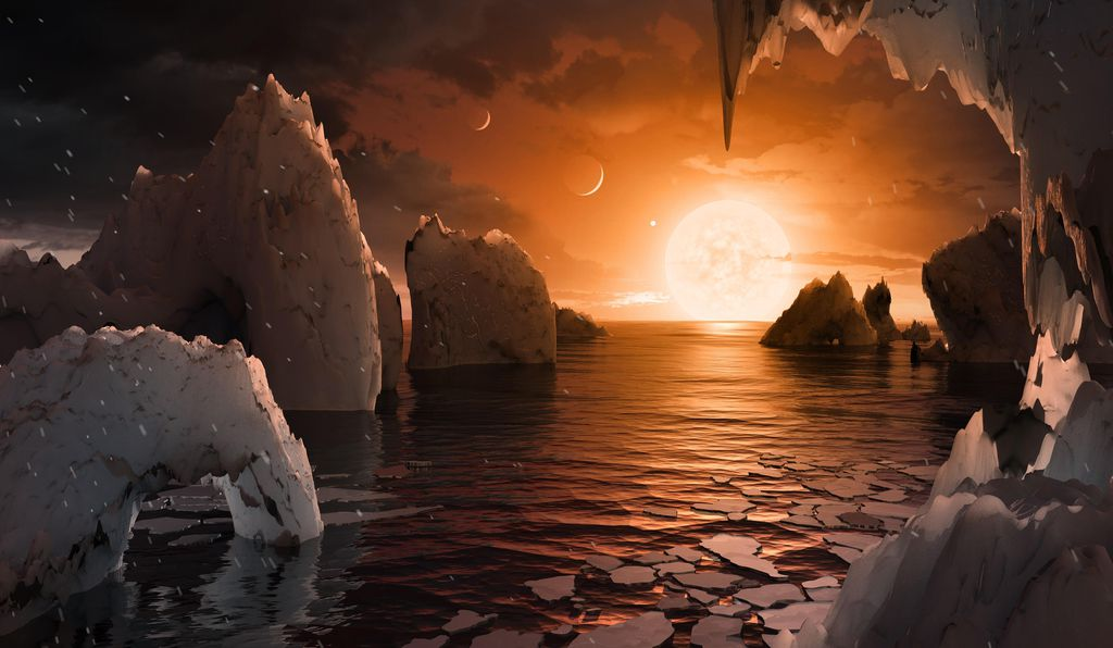 An imagining of what the surface of one of the habitable zone planets of the TRAPPIST-1 system could look like.