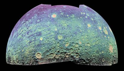The color-coded mosaic is oriented as if the viewer were hovering directly above the lunar South Pole,which lies at the bottom center. In some areas of the surface, the 70-centimeter wavelength penetrates up to 100 feet.