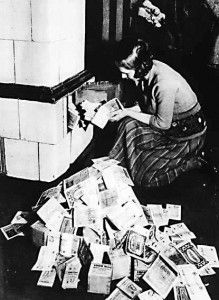 Cheap fuel. A German woman fires her boiler with wads of billion mark notes, autumn 1923.