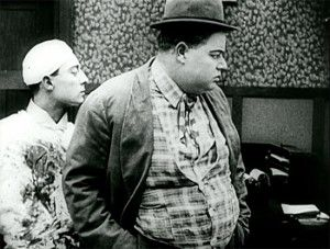 Buster Keaton as a doctor (note his blood-stained smock) and Arbuckle as prospective patient in Good Night, Nurse.