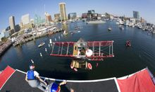 Human-powered airplanes take wing over Baltimore's Inner Harbor.