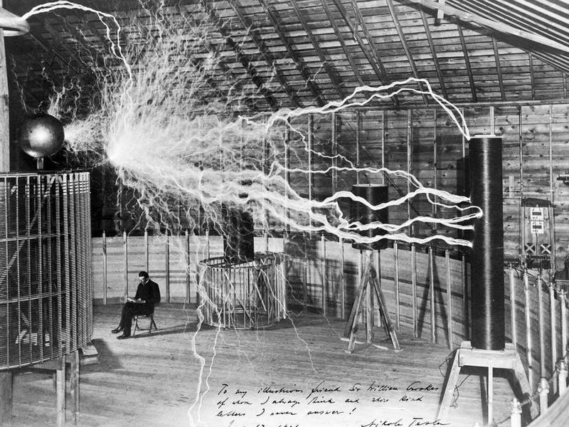 The inventor at rest, with a Tesla coil (thanks to a double exposure)