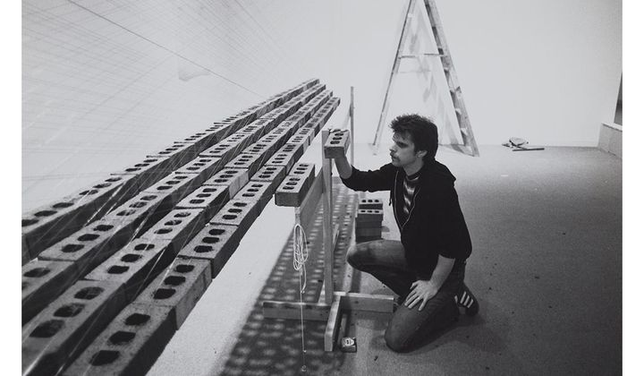Photograph of Loren Madsen with sculpture Inverted Pyramid, Floating at Hirshhorn Museum and Sculpture Garden, 1979 / unidentified photographer. Loren Madsen papers, 1969-2017. Archives of American Art, Smithsonian Institution.