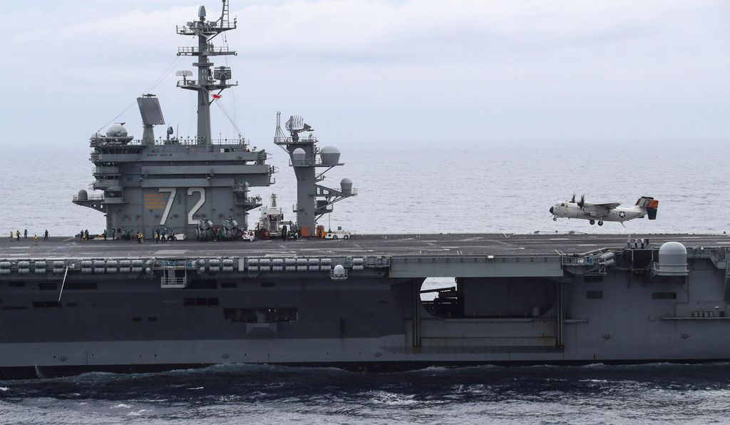 The C-2—unstable in pitch, roll, and yaw—is a handful to fly, much less land aboard an aircraft carrier, yet this crew appears to execute a flawless approach to the <i>Abraham Lincoln</i> in 2018.