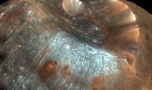 HiRISE takes a colorful closeup of the Martian moon Phobos.