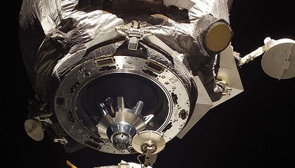 The Soyuz docking assembly's mating adapter is shown in space just feet away from the International Space Station.