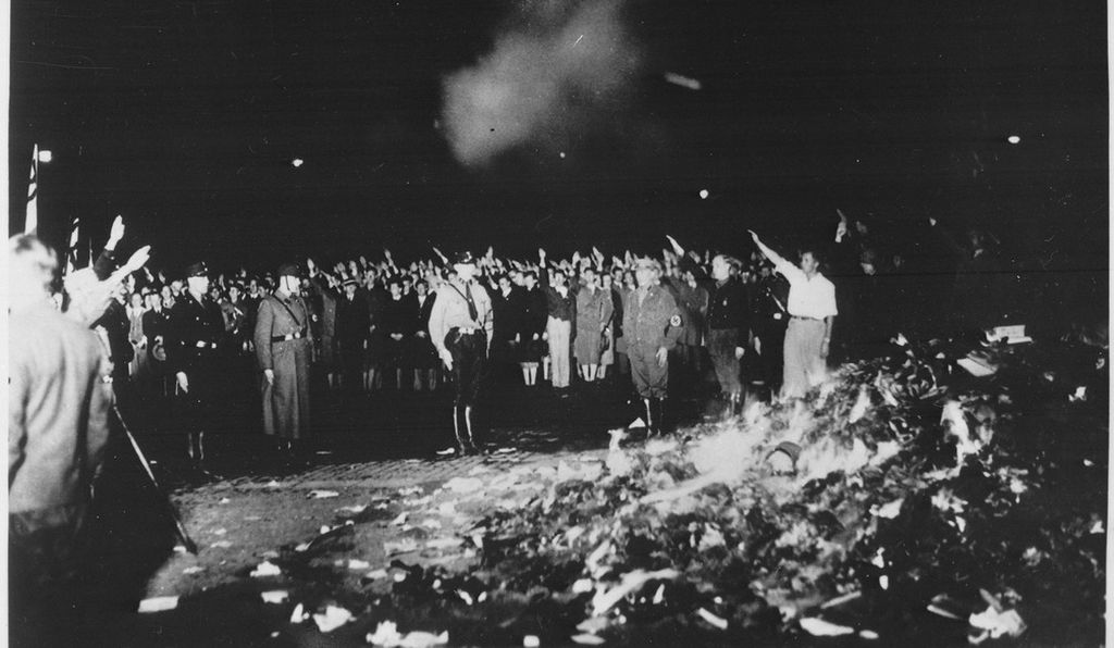 Nazis salute their leader in Berlin's Opera Plaza during a book burning on May 10, 1933, in which some 25,000 volumes were reduced to ashes.