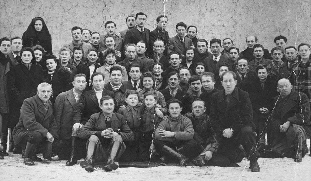 Group portrait of Polish Jewish survivors in Kielce taken in 1945. Many were killed one year later, in the 1946 pogrom.