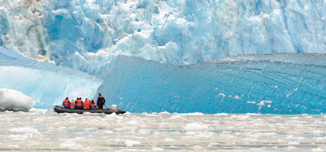 Travelers exploring Hubbard Glacier, Tracy Arm