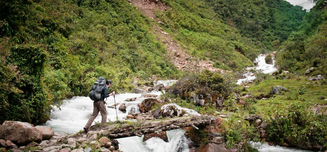 Crossing a river on the Salkantay route