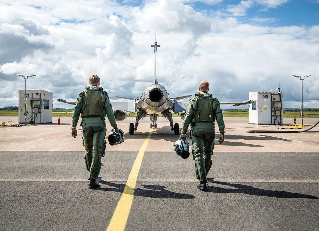 two pilots walking through Gripen