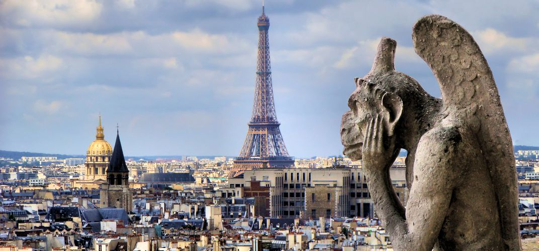 Gargoyle from Notre Dame looking out over Paris