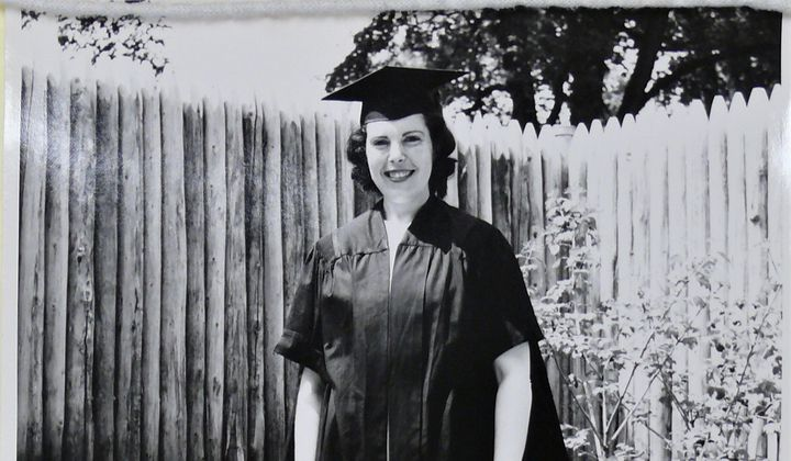Crimilda in cap and gown, Courtesy of Western Michigan University Special Collections, Crimilda Pontes Graphic Arts Archive.