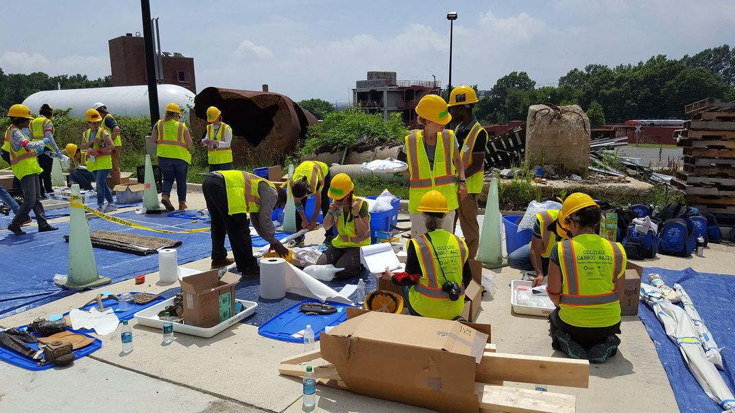 Participants setting up and managing their object recovery area during the final simulation exercise. (Paul Wegener)