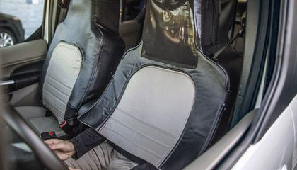Man Dresses Up Like a Car Seat for Science