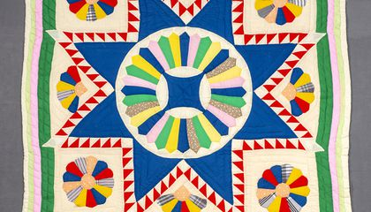 "Dresden Star Medallion Quilt"" by Emma Russell. Object no. 2007.5001.0002 Anacostia Community Museum, Smithsonian Institution."