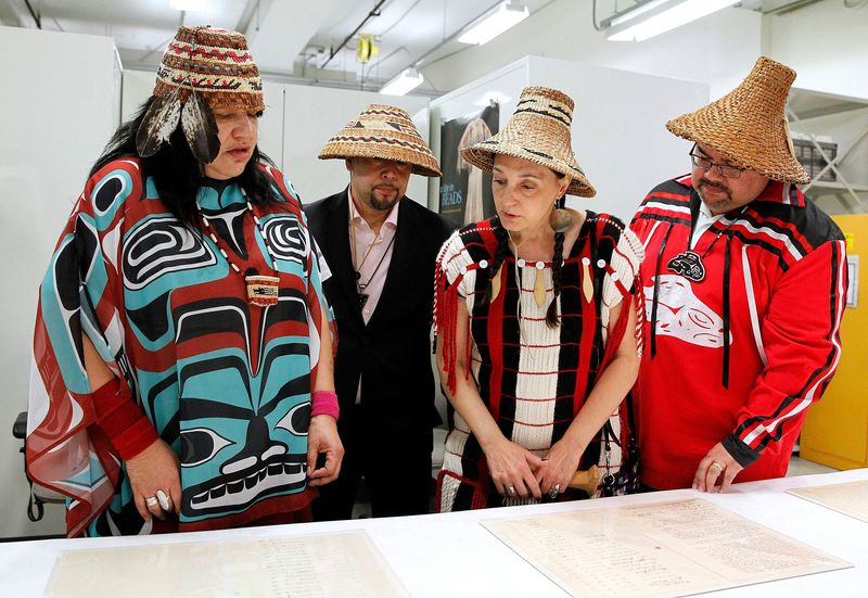 b60ac41a Nisqually tribal member Antonette Squally and Puyallup tribal council  members David Bean, Annette Bryan and Timothy Renyon examine the treaty  before it went ...