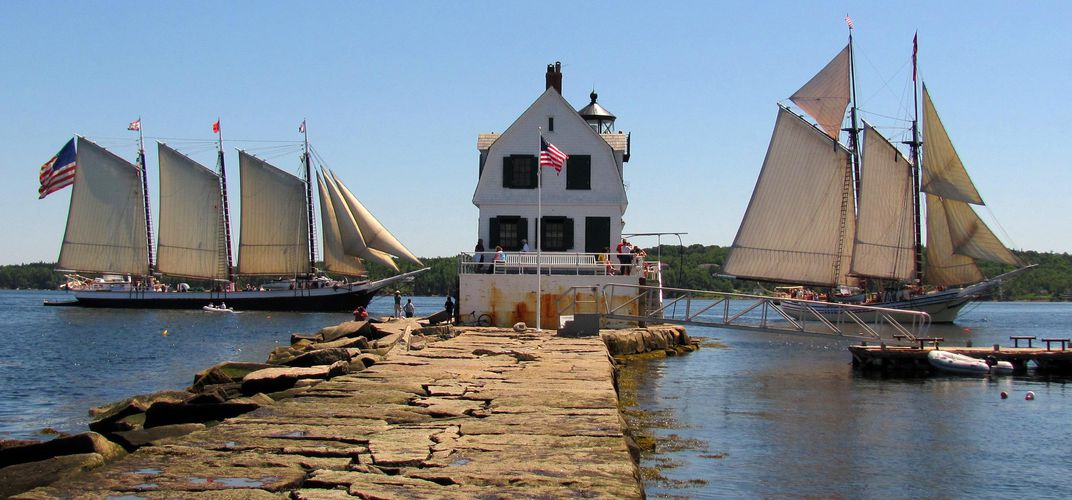 Schooners and breakwater in Rockland. Credit: Courtesy Maine Tourism Bureau