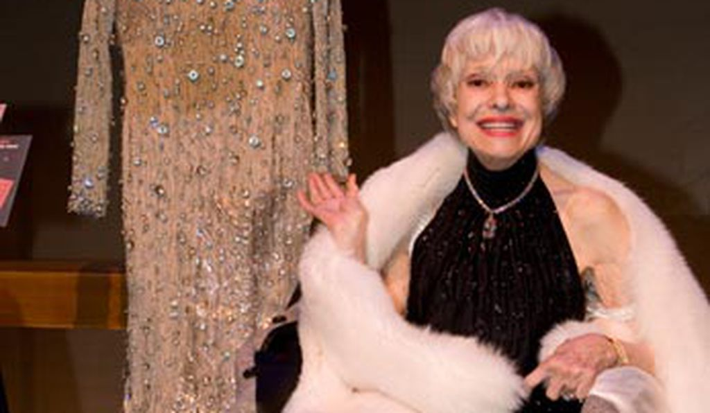 Carol Channing sits next to her diamond encrusted dress that was nearly stolen by a hotel bellhop.