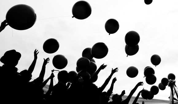 This photo was taken during a groundbreaking ceremony. They released balloons to mark a good fortune for the new building.