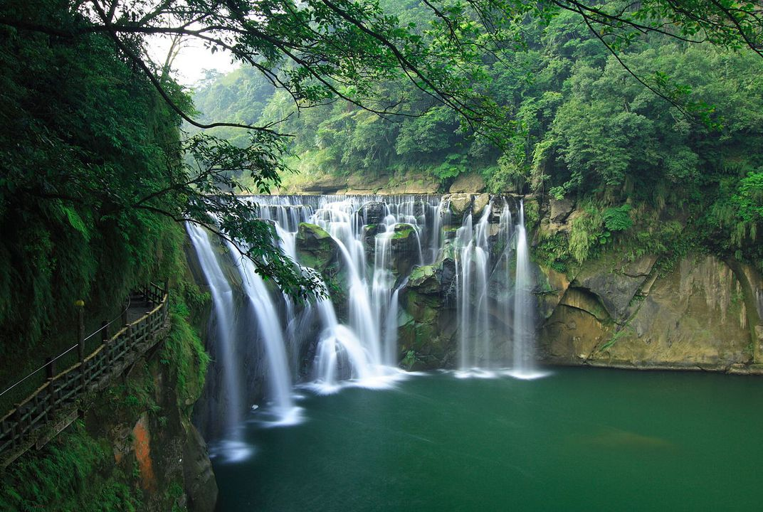 A waterfall is a place where water flows over a vertical drop or a series of steep drops in the course of a stream or river. Waterfalls also occur where meltwater drops over .