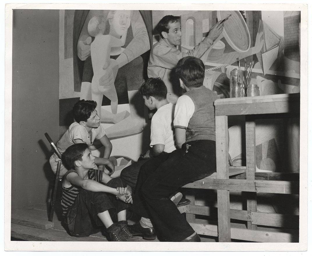 Philip Guston painting a mural in 1940
